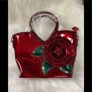 Kaxidy shiny red purse. NWT